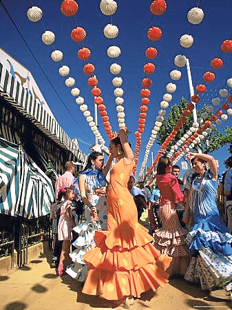 FIESTA: Women in traditional flamenco garb get into the spirit of feria